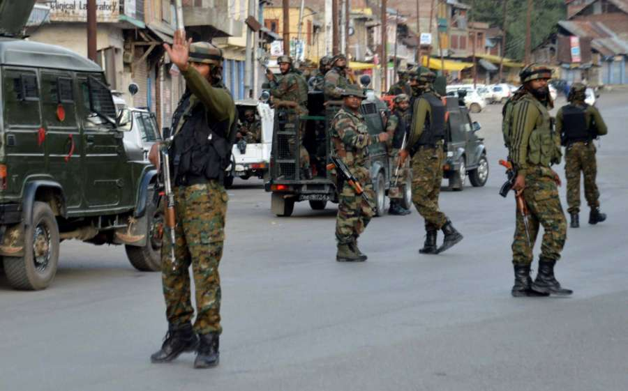 Qazigund: Security forces in action after militants hurled a grenade at the Central Reserve Police Force (CRPF) patrol at Qazigund in Anantnag district of Jammu and Kashmir on Sept 4, 2017. Five CRPF troopers were injured in the attack. (Photo: IANS) by .