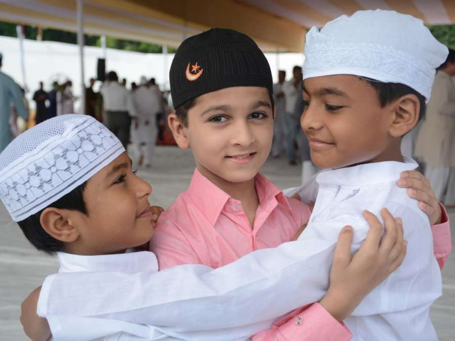 Lucknow: Children greet each other on Eid al-Adha in Lucknow on Sept 2, 2017. (Photo: IANS) by .