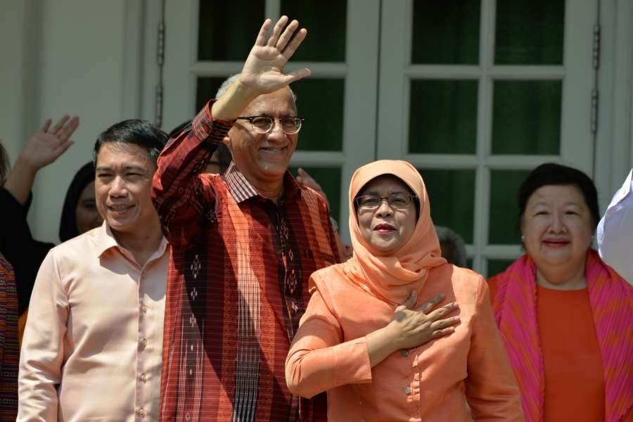 SINGAPORE, Sept. 13, 2017 (Xinhua) -- Former Speaker of Parliament Halimah Yacob (2nd R) greet her supporters at the People's Association headquarters in Singapore on Sept 13, 2017. Halimah Yacob was declared Singapore's eighth president and the first female one on the nomination day. (Xinhua/Then Chih Wey/IANS) by .