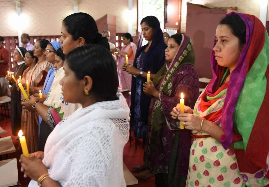 Kochi: People offer thanks giving prayers after Kerala Catholic priest Tom Uzhunnallil, abducted by terrorists in Aden in March last year, has been rescued from captivity from an undisclosed location in Yemen, at Kerala Catholic Bishops' Council (KCBC) headquarters in Kochi, Kerela on Sept 12, 2017. (Photo: IANS) by .