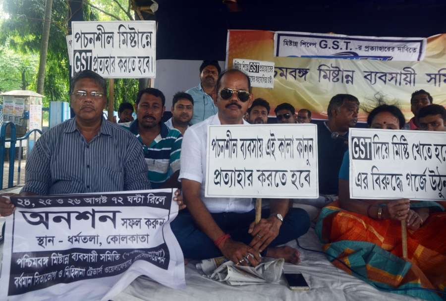 Kolkata: Sweetmeat sellers stage a demonstration against GST imposed on sweets during a hunger strike in Kolkata on Aug 27, 2017. (Photo: Kuntal Chakrabarty/IANS) by .