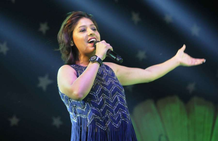 Patna: Singer Sunidhi Chauhan performs during Bihar Diwas in Patna on March 22, 2017. (Photo: IANS) by .