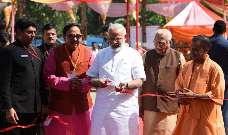 Varanasi: Prime Minister Narendra Modi inaugurates the 'Pashudhan Arogya Mela' at Shahanshahpur in Varanasi, Uttar Pradesh on Sept 23, 2017. Also seen Uttar Pradesh Governor Ram Naik, Chief Minister Yogi Adityanath and State BJP chief Mahendra Nath Pandey. (Photo: IANS/PIB) by .