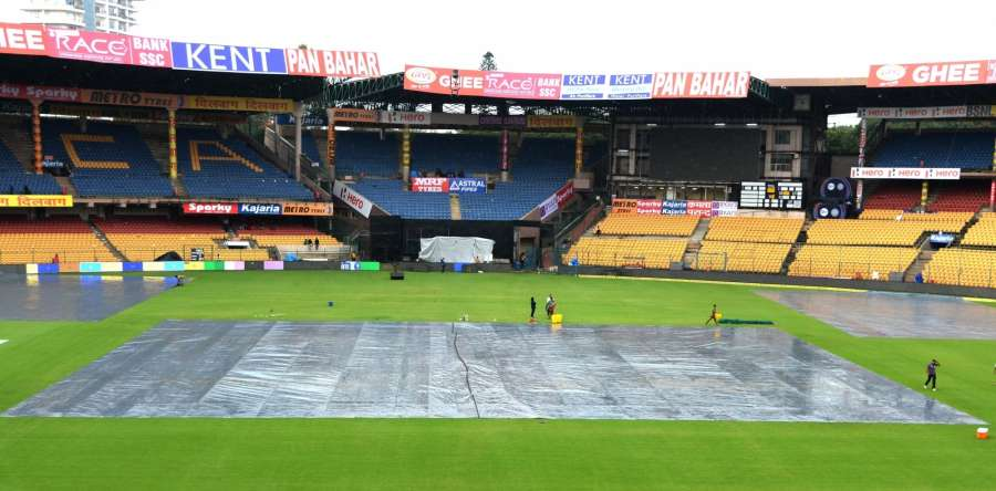 Bengaluru: Pitch being covered ahead of the fourth ODI match between India and Australia during rains at the M. Chinnaswamy Stadium in Bengaluru on Sept 27, 2017. (Photo: IANS) by .