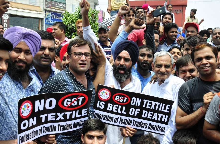 Amritsar: Traders stage a demonstration against Goods and Services Tax (GST), in Amritsar on July 11, 2017. (Photo: IANS) by .