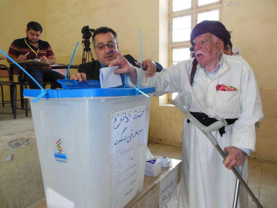 KIRKUK, Sept. 25, 2017 (Xinhua) -- A man casts his vote at a polling station during the referendum vote in disputed Iraqi city of Kirkuk, on Sept. 25, 2017. The Iraqi Kurds on Monday cast their votes in a referendum that will determine the independence of the Kurdish region and the disputed areas that are currently under de facto Kurdish control. (Xinhua/Ako Jihad/IANS) by .