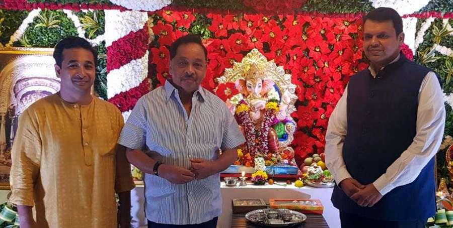 Mumbai: Senior Congress leader Narayan Rane along with son Nitesh Narayan Rane visits the residence of Maharashtra Chief Minister Devendra Fadnavis for Ganesh pooja during Ganesh Chaturthi celebrations in Mumbai on Aug 26, 2017. (Photo: IANS) by .