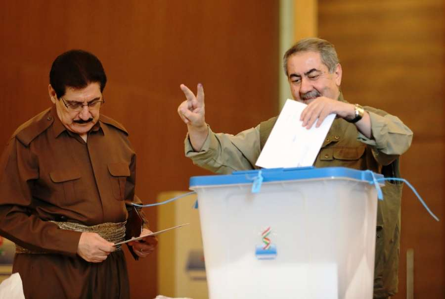 ERBIL, Sept. 25, 2017 (Xinhua) -- Iraqi former Foreign Minister Hoshiar Mahmoud al-Zibari (R) casts his vote during the referendum vote in Erbil, Iraq, on Sept. 25, 2017. The Iraqi Kurds on Monday cast their votes in a referendum that will determine the independence of the Kurdish region and the disputed areas that are currently under de facto Kurdish control. (Xinhua/Khalil Dawood/IANS) by .