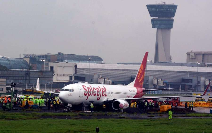 Mumbai: The Mumbai Airport's main runway remained closed as work on towing out a stranded SpiceJet airlines aircraft continued amid heavy rains, low visibility and strong winds at the Chhatrapati Shivaji International Airport in Mumbai on Sept 20, 2017. (Photo: IANS) by .