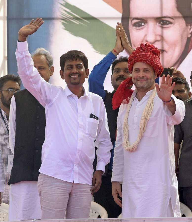Gandhinagar: Congress Vice President Rahul Gandhi with Gujarat OBC leader Alpesh Thakore who joined the party during a public meeting in Gandhinagar on Oct 23, 2017. (Photo: IANS) by .