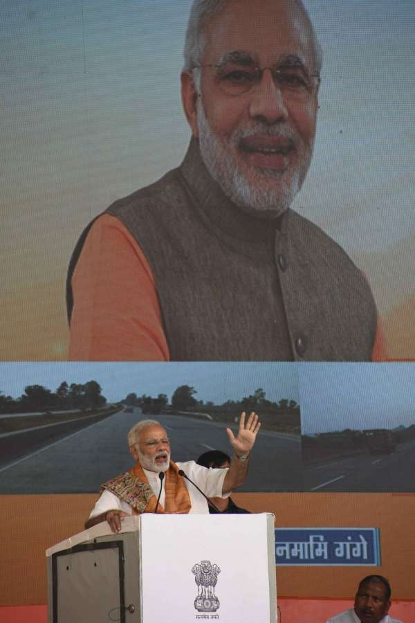 Mokama: Prime Minister Narendra Modi addresses at a programme to lay the foundation stones for Namami Gange and National Highway projects in Mokama, Bihar on Oct 14, 2017. (Photo: IANS) by .
