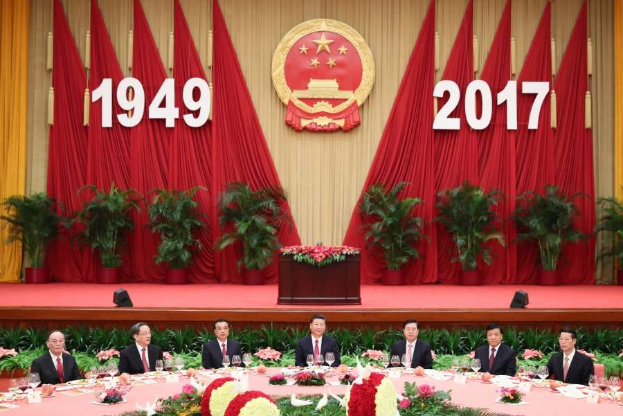 BEIJING, Sept. 30, 2017 (Xinhua) -- Chinese President Xi Jinping (C), Premier Li Keqiang (3rd L), and other senior leaders Zhang Dejiang (3rd R), Yu Zhengsheng (2nd L), Liu Yunshan (2nd R), Wang Qishan (1st L) and Zhang Gaoli (1st R) attend a reception held by the State Council to celebrate the 68th anniversary of the founding of the People's Republic of China, in Beijing, capital of China, Sept. 30, 2017. (Xinhua/Lan Hongguang/IANS) by .