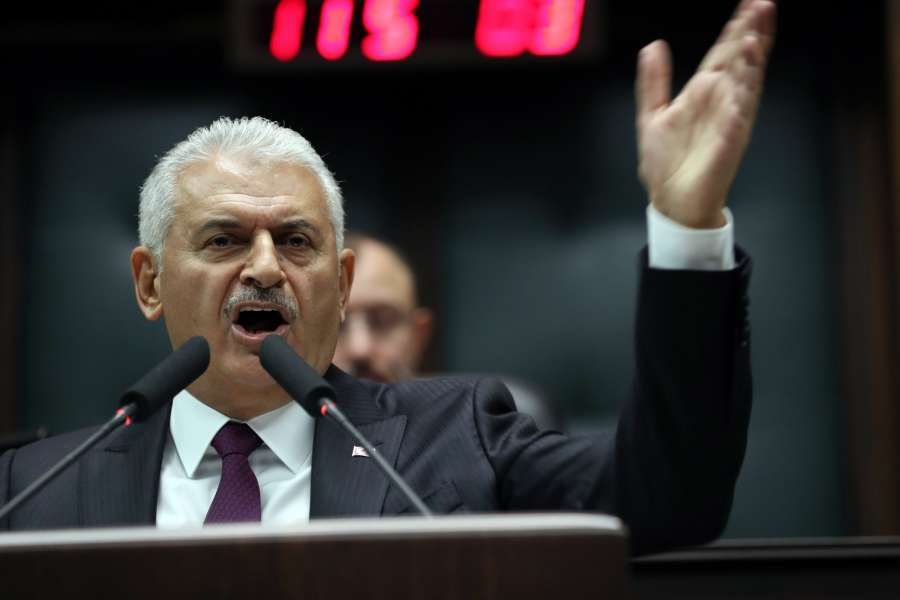 ANKARA, Oct. 10, 2017 (Xinhua) -- Turkish Prime Minister Binali Yildirim addresses the ruling Justice and Development Party (AKP)'s weekly parliamentary group meeting in Ankara, Turkey, on Oct. 10, 2017. Yildirim said on Tuesday that Turkey will not ask the United States for permission to detain or prosecute suspects. The spat between the two countries was ignited by the recent arrest of Metin Topuz, a U.S. consulate employee in Istanbul, over suspected links to U.S.-based Muslim cleric Fethullah Gulen, who is accused by Ankara of being behind a failed coup attempt in July 2016. (Xinhua/Mustafa Kaya/IANS) by .