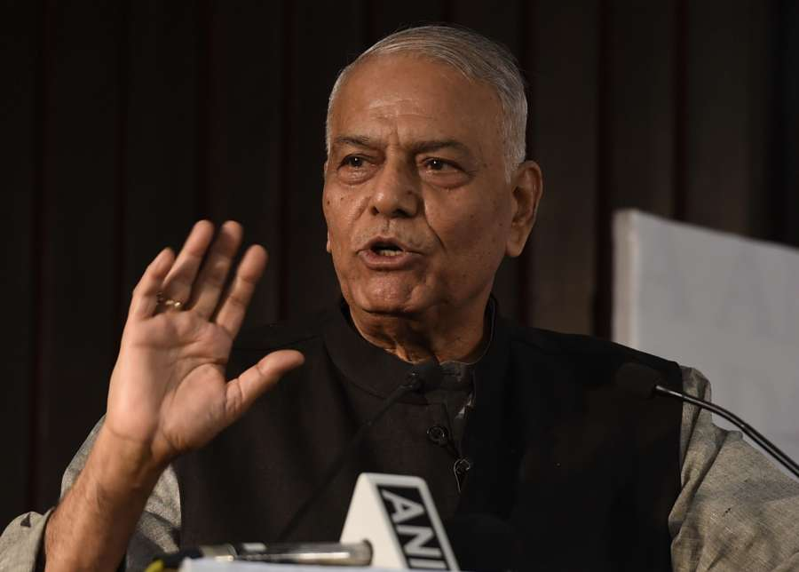 """New Delhi: BJP leader Yashwant Sinha addresses at the release of Congress leader Manish Tewari's book """"Tidings of Troubled Times"""" in New Delhi, on Oct 5, 2017. (Photo: IANS) by ."""