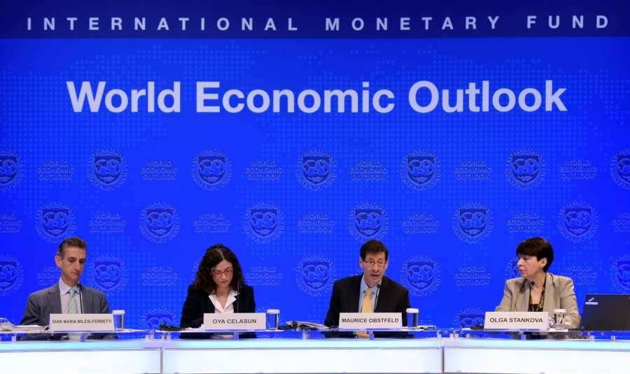 WASHINGTON, Oct. 10, 2017 (Xinhua) --Maurice Obstfeld (2nd R), chief economist at the International Monetary Fund (IMF), attends a press briefing at the IMF headquarters in Washington D.C., the United States, on Oct. 10, 2017. The IMF on Tuesday raised its global growth forecast for 2017 and 2018 due to a broad-based recovery in Europe, China, Japan and the United States. (Xinhua/Yin Bogu/IANS) by .
