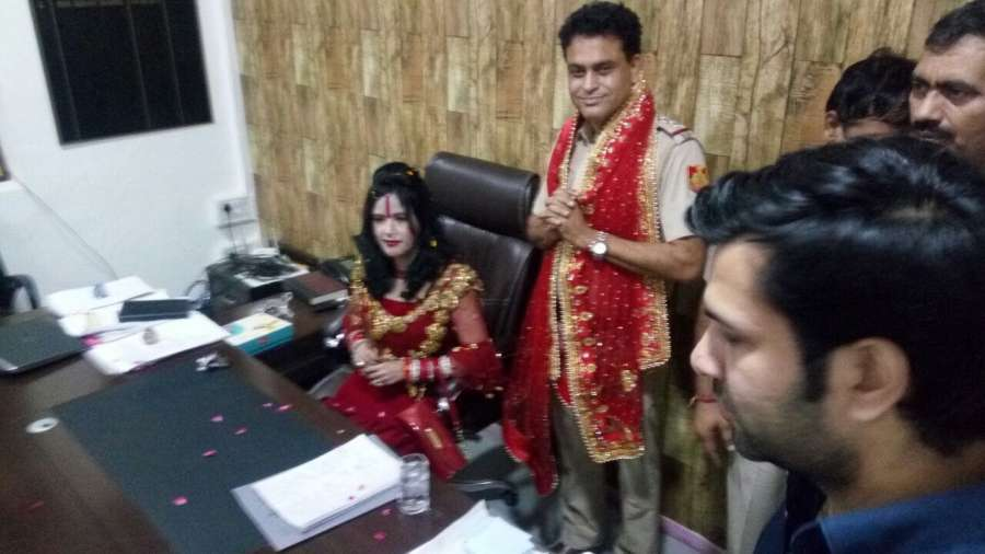 New Delhi: Self-styled godwoman Radhe Maa seated on the chair of Station House Officer (SHO) of Vivek Vihar police station in New Delhi on Oct 5, 2017. SHO Sanjay Sharma is seen standing next to her with folded hands. (Photo: IANS) by .