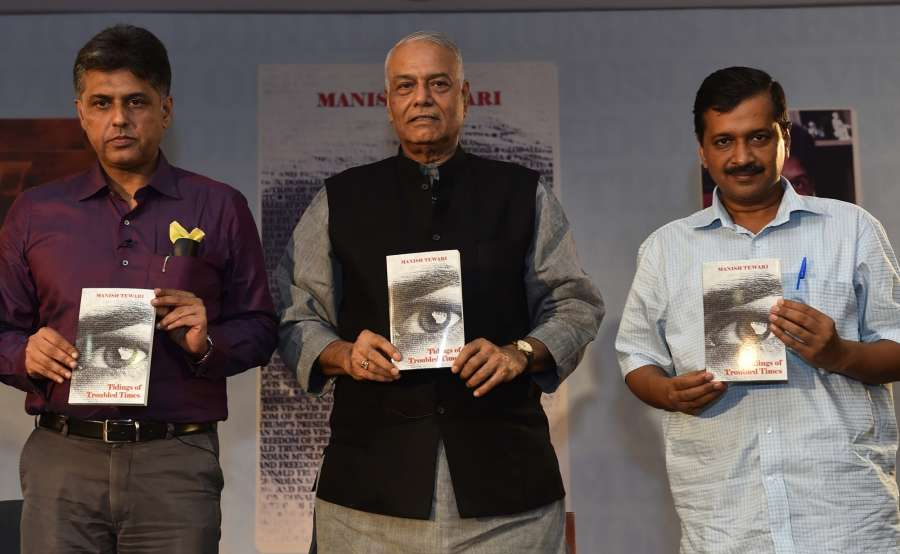 """New Delhi: Delhi Chief Minister Arvind Kejriwal and BJP leader Yashwant Sinha at the release of Congress leader Manish Tewari's book """"Tidings of Troubled Times"""" in New Delhi, on Oct 5, 2017. (Photo: IANS) by ."""