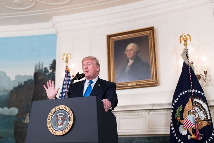 """WASHINGTON, Oct. 13, 2017 (Xinhua) -- U.S. President Donald Trump speaks on new Iran strategy at the White House in Washington D.C., the United States, on Oct. 13, 2017. U.S. President Donald Trump rolled out his new Iran strategy on Friday, vowing to deny Tehran """"all paths to a nuclear weapon"""" in a major shift in Washington's Iran policy. (Xinhua/Ting Shen/IANS) by ."""