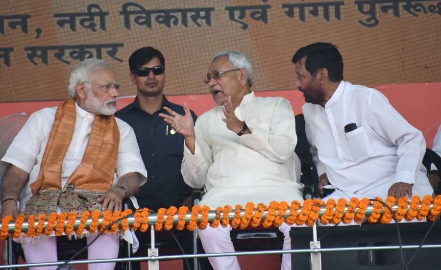 Mokama: Prime Minister Narendra Modi, Bihar Chief Minister Nitish Kumar and Union Consumer Affairs, Food and Public Distribution Minister Ramvilas Paswan during a programme organised to lay the foundation stones for Namami Gange and National Highway projects in Mokama, Bihar on Oct 14, 2017. (Photo: IANS) by .