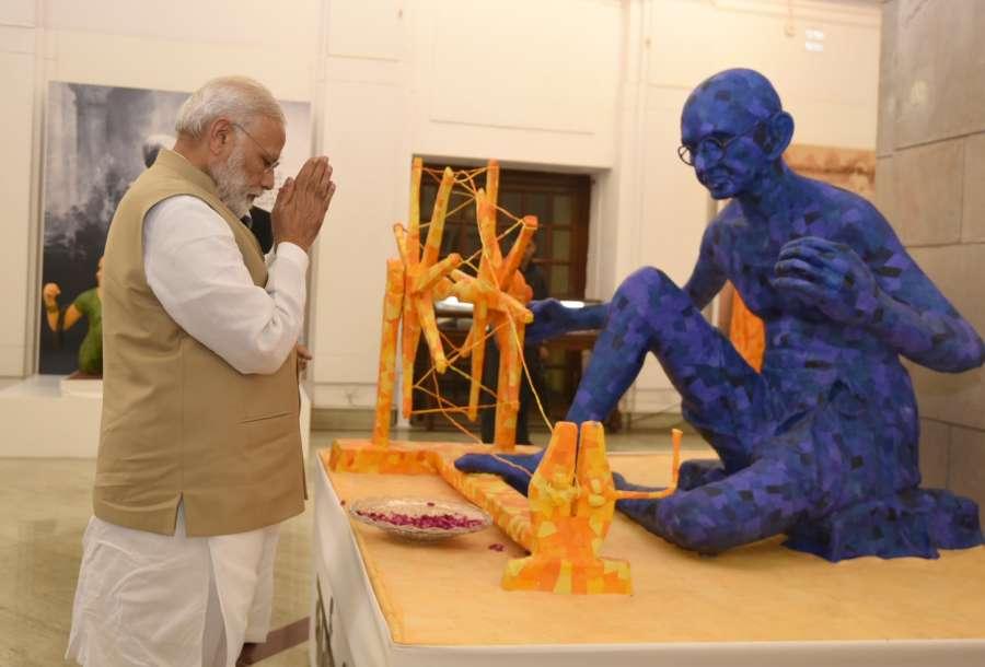 "New Delhi: Prime Minister Narendra Modi visits ""Swachchhagrah – Bapu Ko Karyanjali - Ek Abhiyan, Ek Pradarshani"" an exhibition organised by the National Archives of India to mark the 100 years of Mahatma Gandhi's first experiment of Satyagraha in Champaran, in New Delhi on April 10, 2017. (Photo: IANS/PIB) by ."