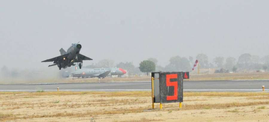 """Bhatinda: IAF chief B.S. Dhanoa flies a MiG-21 at Air Force station in Bhisiana of Punjab's Bhatinda, """"to honour the valour and supreme sacrifice of Kargil martyrs"""" on May 27, 2017. (Photo: IANS/DPRO) by ."""