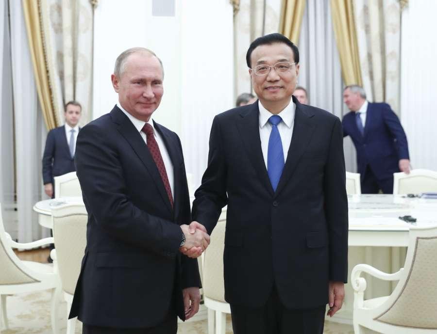 MOSCOW, Nov. 29, 2017 (Xinhua) -- Chinese Premier Li Keqiang (R) meets with Russian President Vladimir Putin at the Kremlin in Moscow, Russia, Nov. 29, 2017. (Xinhua/Xie Huanchi/IANS) by .
