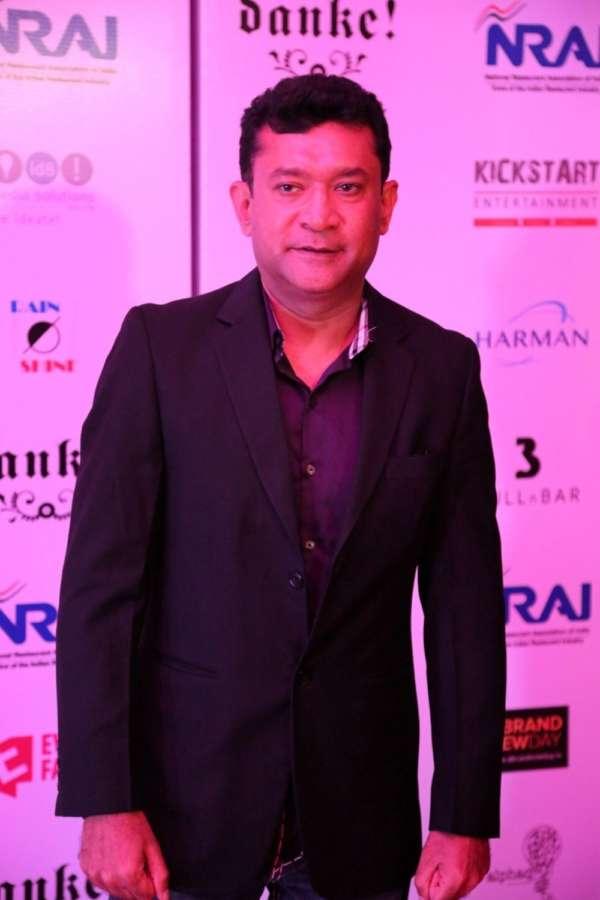 Mumbai: Filmmaker Ken Ghosh during the India Nightlife Convention Awards in Mumbai. (Photo: IANS) by .