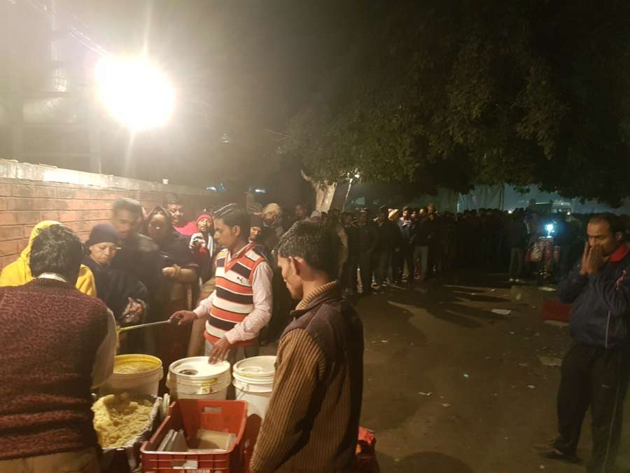 People queueing up at the PGI gate langar. by .