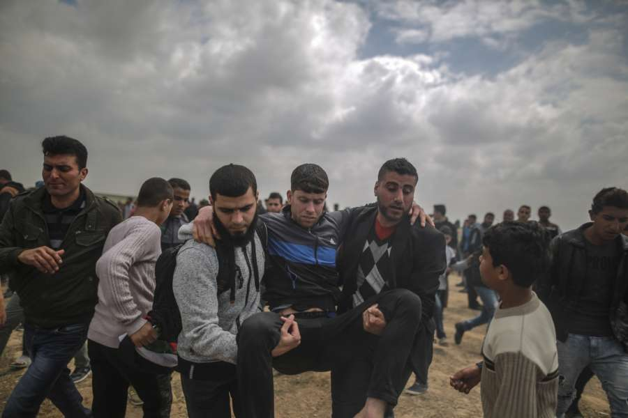 GAZA, March 30, 2018 (Xinhua) -- A wounded Palestinian is evacuated during a protest along the border fence between Gaza Strip and Israel in Gaza City, March 30, 2018. Although the anti-Israel Palestinian mass rally in Gaza was supposed to go peaceful, the demonstrations turned violent, leaving at least 16 Palestinians killed and over 1,400 others injured. (Xinhua/Wissam Nassar/IANS) by .