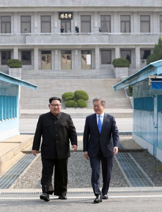 Panmunjom: South Korean President Moon Jae-in (R) and North Korean leader Kim Jong-un head to a summit site at the truce village of Panmunjom on April 27, 2018.(Yonhap/IANS) by .