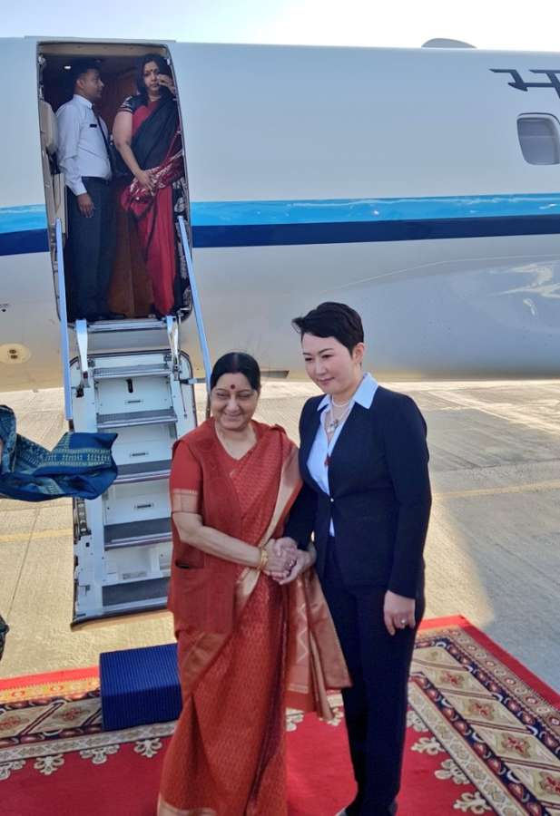 Ulaanbaatar: External Affairs Minister Sushma Swaraj being received by Mongolian Deputy Foreign Minister B. Battsetseg on her arrival in Ulaanbaatar, Mongolia on April 24, 2018. (Photo: IANS/MEA) by .