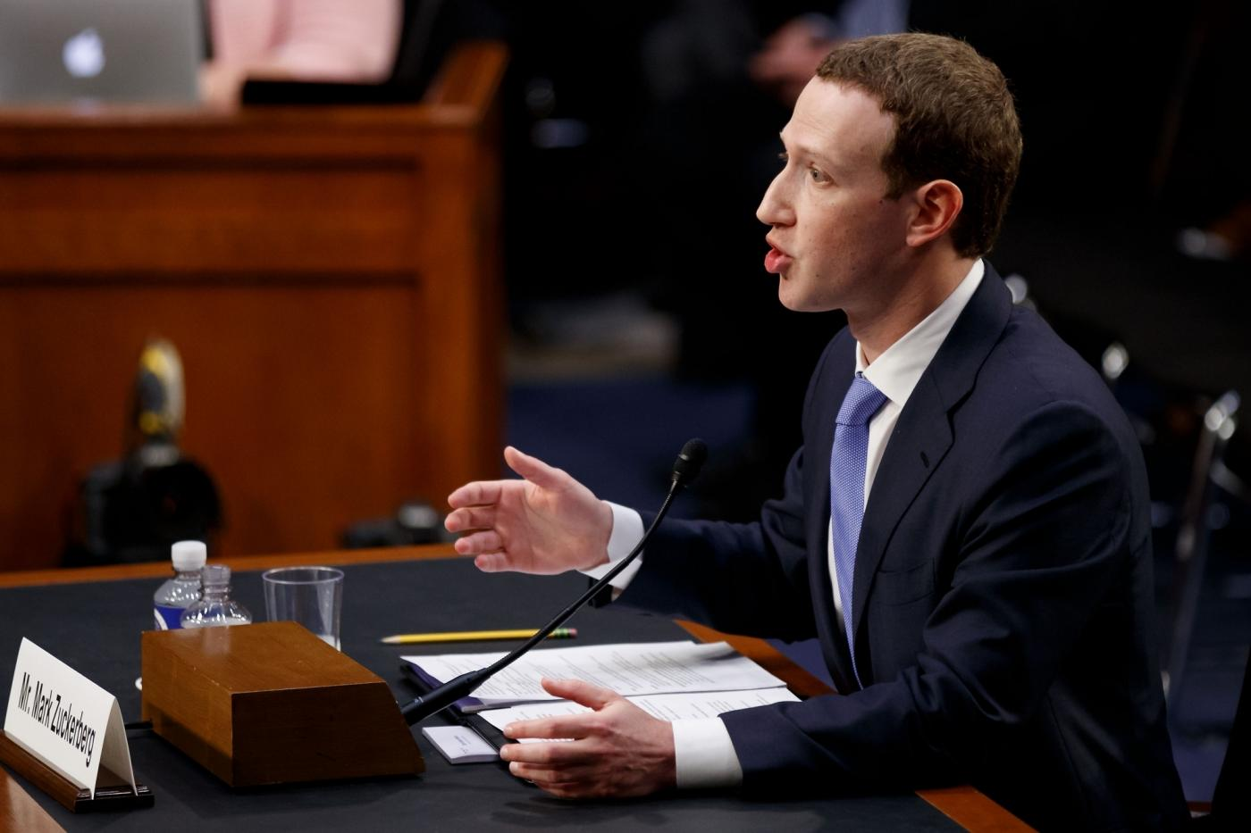 """WASHINGTON, April 10, 2018 (Xinhua) -- Facebook CEO Mark Zuckerberg testifies at a joint hearing of the Senate Judiciary and Commerce committees on Capitol Hill in Washington D.C., United States, on April 10, 2018. Facebook CEO Mark Zuckerberg told Congress in written testimony on Monday that he is """"responsible for"""" not preventing the social media platform from being used for harm, including fake news, foreign interference in elections and hate speech. (Xinhua/Ting Shen/IANS) by ."""