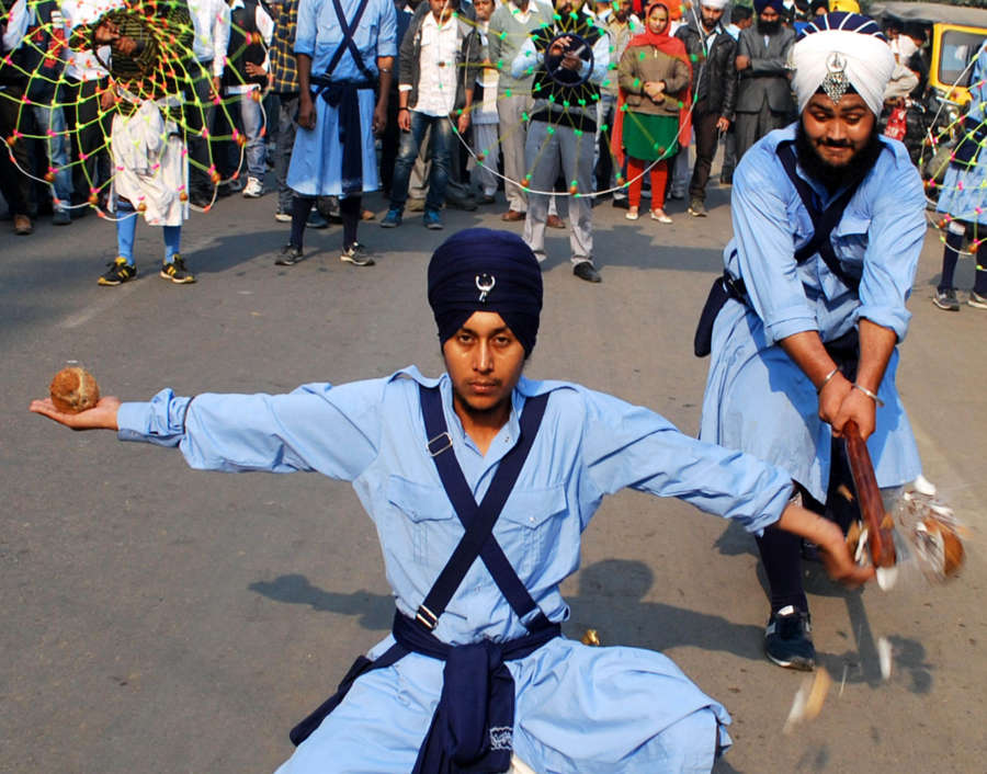 Young Sikh Nihangs or warriors demonstrate their 'Gatka' skills during a religious procession outside Golden Temple on the eve of 545 birth anniversary of Guru Nanak Dev the first Sikh Guru in Amritsar on Nov.16, 2013. (Photo: IANS) by IANS.