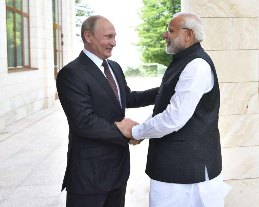 Sochi: Prime Minister Narendra Modi meets Russian President Vladimir Putin in Sochi, Russia on May 21, 2018. (Photo: IANS/MEA) by .
