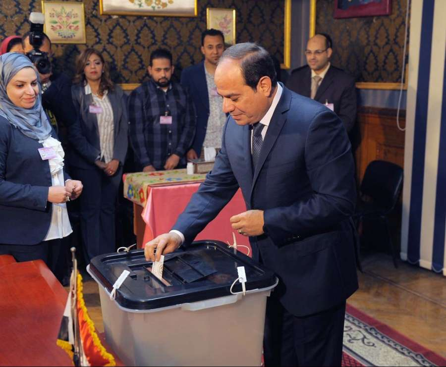 CAIRO, March 26, 2018 (Xinhua) -- Egyptian President Abdel-Fattah al-Sisi (R) casts his ballot at a polling station in Cairo, Egypt, on March 26, 2018. Voting of Egypt's presidential election began on Monday. (Xinhua/MENA/IANS) by .