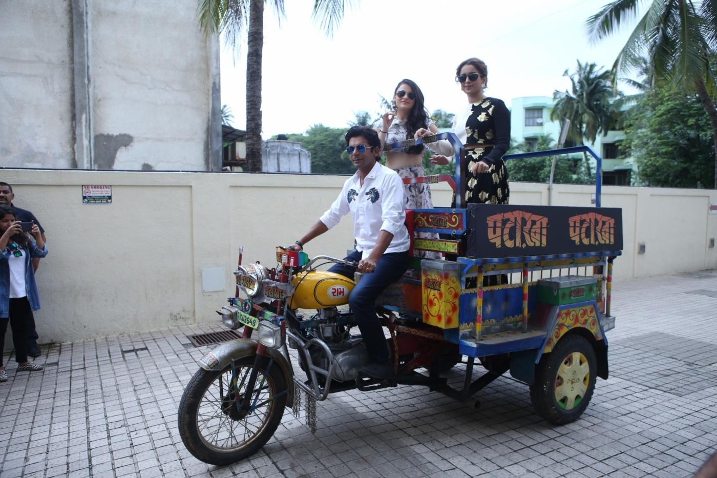 "Mumbai: Actors Sunil Grover, Sanya Malhotra and Radhika Madan at the song launch of film ""Pataakha"", in Mumbai on Aug 28, 2018. (Photo: IANS) by ."