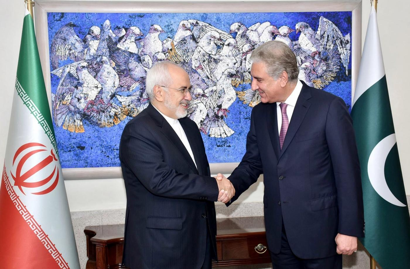 ISLAMABAD, Aug. 31, 2018 (Xinhua) -- Photo released by Pakistan's Press Information Department (PID) on Aug. 31, 2018 shows that Pakistani Foreign Minister Shah Mahmood Qureshi (R) shakes hand with his Iranian counterpart Mohammad Javad Zarif in Islamabad, capital of Pakistan. Pakistan on Friday expressed its support to Iran on the international nuclear deal related to the Iranian nuclear issue during talks between foreign ministers of the two countries, the Foreign Ministry said. (Xinhua/PID/IANS) by .