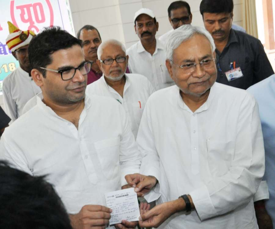 Patna: Bihar Chief Minister and JD-U chief Nitish Kumar with election strategist Prashant Kishor during a programme where the latter joined JD-U, in Patna on Sept 16, 2018. Kishor, 41-year-old former UN official, who founded the Indian Political Action Committee (I-Pac), was tasked with running the JD-U's campaign during the 2015 Bihar polls after he parted ways with the Bharatiya Janata Party (BJP). (Photo: IANS) by .