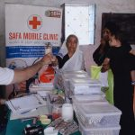 Medicines being given to the needy. by .