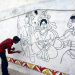 Patna: An artist decorates a wall with Madhubani art at Kali Ghat ahead of Chhath Puja in Patna, on Nov 10, 2018. (Photo: IANS) by .