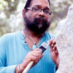 Adwaita Garanayak sculpting the memorial. by .