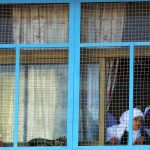 AMMAN, Oct. 17, 2018 (Xinhua) -- Palestinian refugee students look out of the window at a school of Baqa'a Palestinian refugee camp in Amman, Jordan, on Oct. 16, 2018. (Xinhua/Mohammad Abu Ghosh/IANS) by .