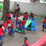 Children of both indigenous tribes and forest officers play together in the playground. by .