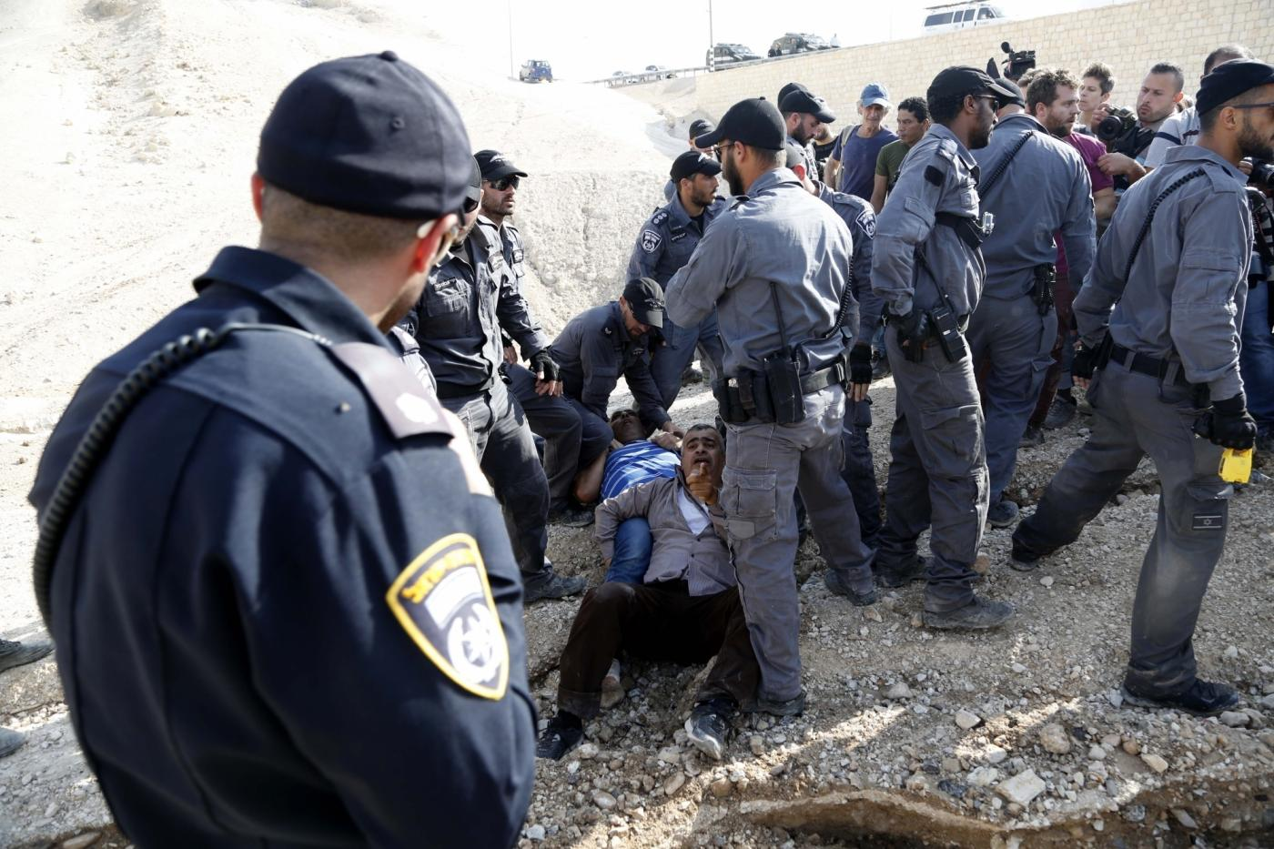 JERICHO, Oct. 15, 2018 (Xinhua) -- Israeli forces detain activists at the Palestinian Bedouin community of Khan al-Ahmar that Israel plans to demolish, located between the West Bank city of Jericho and Jerusalem, on Oct. 15, 2018. Khan al-Ahmar is a Bedouin community built without permission, according to the Israeli authorities. (Xinhua/Mamoun Wazwaz/IANS) by .