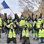 """PARIS, Dec. 8, 2018 (Xinhua) -- """"Yellow Vests"""" protesters shout slogans near the Arch of Triumph in Paris, France, on Dec. 8, 2018. Riot police fired tear gas and water cannon at """"Yellow Vests"""" protesters marching in Paris on Saturday in the fourth week-end action despite President Emmanuel Macron's series of concessions. (Xinhua/Chen Yichen/IANS) by ."""