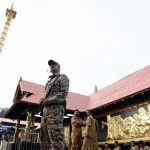 """Pathanamthitta: A security personnel stands guard at the Sabarimala temple in Kerala's Pathanamthitta district on Nov 17, 2018. A Hindu group on Saturday called for a shutdown in Kerala following the """"detention"""" of few religious leaders the previous night from the Sabarimala temple premises. The most prominent among the detained on Friday night were Hindu Iykavedi (HI) President and senior BJP leader K.P. Sasikala. She was detained while proceeding towards the Lord Ayyappa shrine. (Photo: IANS) by ."""