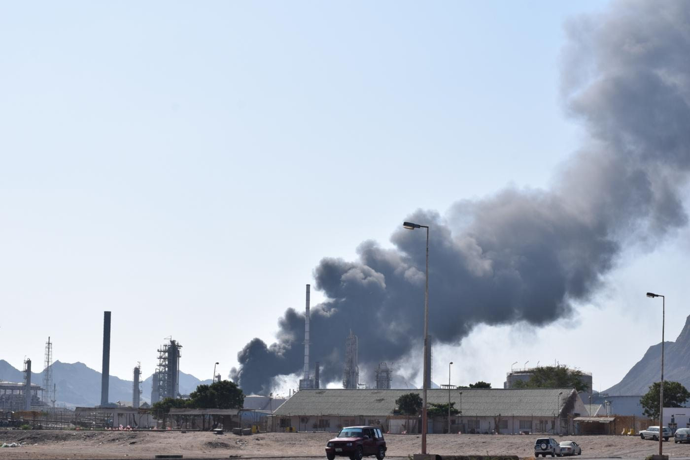 ADEN, Jan. 12, 2019 (Xinhua) -- Photo taken on Jan. 12, 2019 shows heavy smoke at a state-owned oil refinery company in Aden, Yemen, on Jan. 12, 2019. A huge fire broke out on Friday evening at the state-owned oil refinery company in Yemen's southern port city of Aden, causing no casualties. (Xinhua/Murad Abdo/IANS) by .