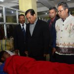 Golaghat: Assam Chief Minister Sarbananda Sonowal interacts with the victims of Assam hooch tragedy at Golaghat Civil Hospital in Assam on Feb 23, 2019. (Photo: IANS) by .
