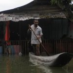 SENTANI, March 20, 2019 (Xinhua) -- A man rides a boat through flood water in Sentani, Papua province, Indonesia, March 19, 2019. Indonesian disaster authorities have put the death toll of flash floods and landslides in eastern province of Papua at 89 while the search and rescue operation for 74 missing persons continues, official said here on Tuesday. (Xinhua/Ikha/IANS) by .