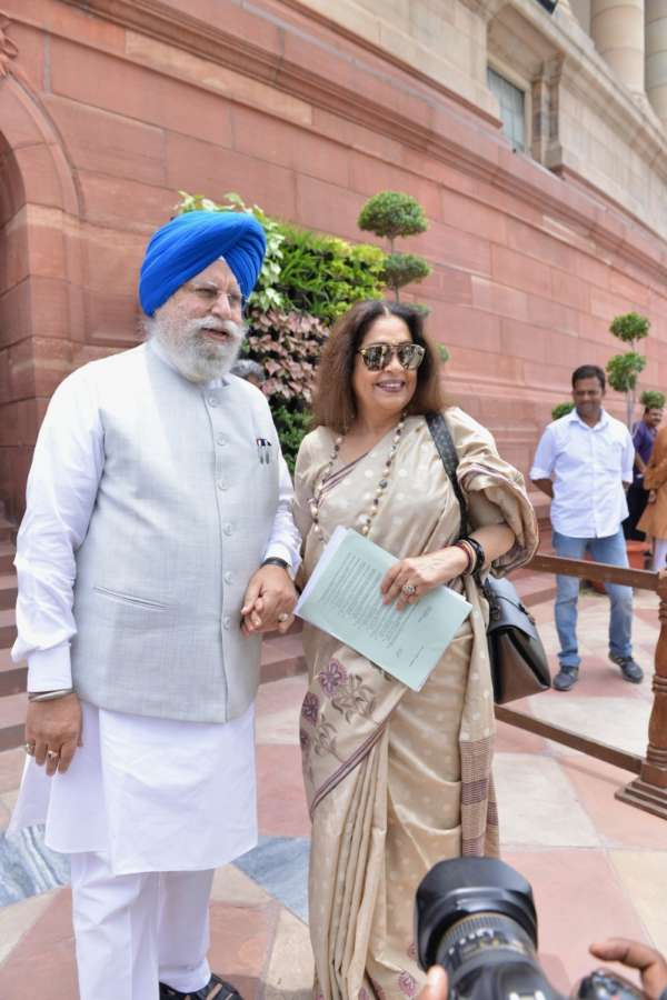 New Delhi: BJP MPs S. S. Ahluwalia and Kirron Kher at Parliament, in New Delhi on July 30, 2018. (Photo: IANS) by .